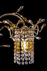 Chandelier details for a modern interior. crystal chandelier for hallway, living room or bedroom. Isolated on black.