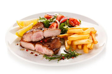Roast steak with french fries on white background
