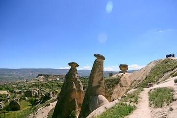 Three Graces, three Beautifuls (uc guzeller) rock hills in Devrent valley, Cappadocia, Nevsehir, Turkey