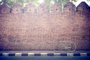 Bike on brick wall