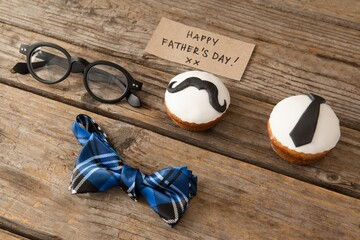 Happy fathers day text by decorated cupcakes