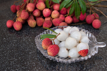 Litchi fruits. Fresh juicy lychee fruit on a glass plate. Peeled lychee fruit.