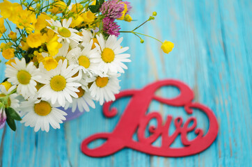 The inscription on the wooden background love about flowers