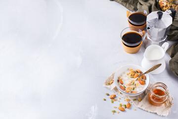 Breakfast with black coffee muesli granola honey nuts milk