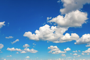 Blue sky with fluffy clouds as background