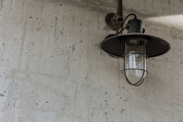 industrial street light decoration. white wall lighting vintage retro style in black and white with space for text.