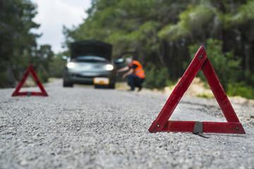 Repairman near broken down car
