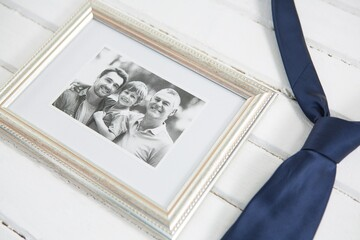 High angle view of picture frame by necktie on table