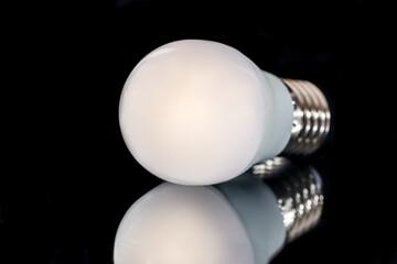 white LED light bulb isolated on black background. close up