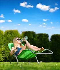 Woman relaxing on lounger in the garden.