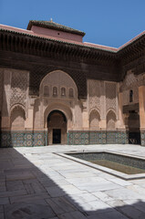 Carving of wood and stone. lInner cortyard of Medersa of Ben Youssef, Marrakech,Morocco