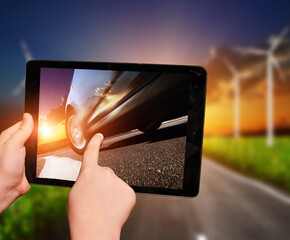 Tablet in hands with imageof truck