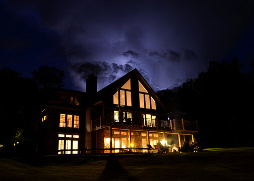 Lightning storm over a cabin