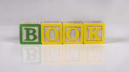 book spelled in blocks