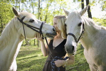 Female with Blonde Hair Kissing Her White Horse in Rural Virginia