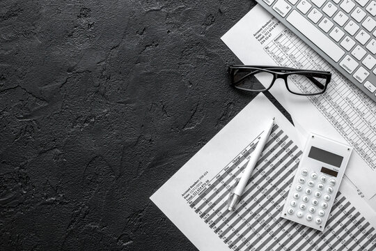 taxes accounting in office work space on dark desk background top view mockup