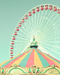 Vintage ferris wheel and carousel tent