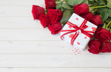 Gift box with hearts. Red roses. White background.