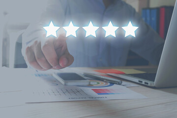 evaluation concept. Businessman pointing five star to increase rating of company.
