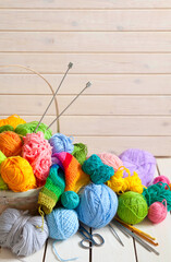 Colored balls of yarn. View from above. Rainbow colors. Yarn for knitting. Skeins of yarn.