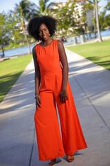 Woman posing in a retro orange dress
