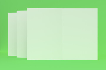 Three blank white open brochure mock-up on green background