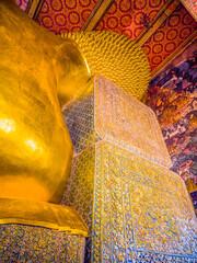 giant reclining golden Buddha statue at Wat Pho Bangkok Thailand