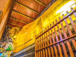 giant reclining golden Buddha statue at Wat Pho Bangkok Thailand