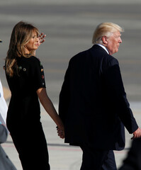 U.S. President Donald Trump and first lady Melania Trump leave after delivering remarks to U.S. military personnel at the Naval Air Station Sigonella following the G7 Summit, in Sigonella, Sicily