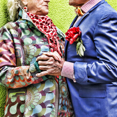 Movie effect. Elderly man passionately in love is explained by an elderly lady on a green wall. Love and passion.