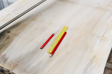 work pencils and a ruler on a piece of wood