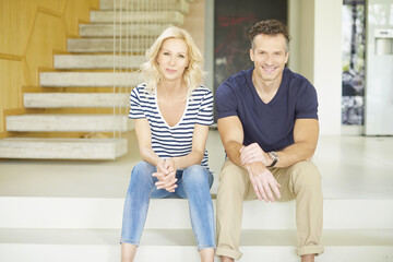 Shot of a cheerful couple relaxing at home.