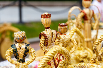 Handmade dolls made from straw at an exhibition of folk arts