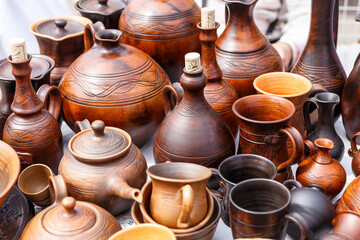 Clay handmade pots are sold at the exhibition of folk handicrafts