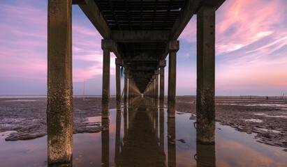 Decay under bridge port in twilight time..