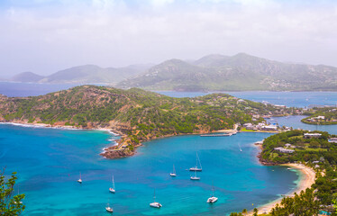 Aluminium Prints Caribbean Antigua, Caribbean islands, English harbour view with Freeman's bay and yachts anchored by the beach