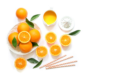 Orange juice and oranges isolated on white background top view.