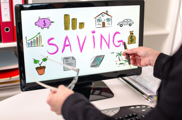 Saving concept on a computer monitor
