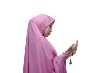 Young asian muslim woman with prayer beads praying