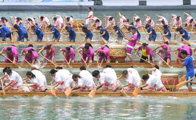 Participants take part in a dragon boat race to celebrate Dragon Boat festival in Tongren, Guizhou