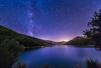 purple night sky stars lake landscape with milky way on mountain background