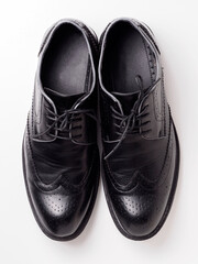 Black leather shoe pair