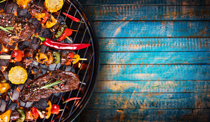 Photo on textile frame Grill / Barbecue Barbecue grill with beef steaks, close-up.
