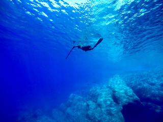 spearfishing in the blue mediterranean sea water