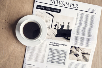 Newspaper with coffee on table