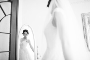 The beautiful bride looking at mirror