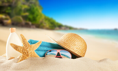 Tropical beach with accessories, summer holiday background.