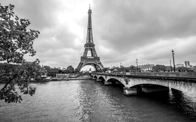 Paris Eiffel Tower from Seine. Cityscape in black and white
