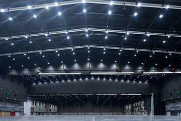 Large empty hall and lighting on ceiling.