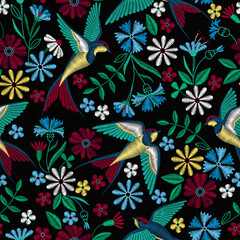 Embroidery seamless pattern with swallow birds and beautiful flowers. Vector embroidery for fashion textile and fabric.
